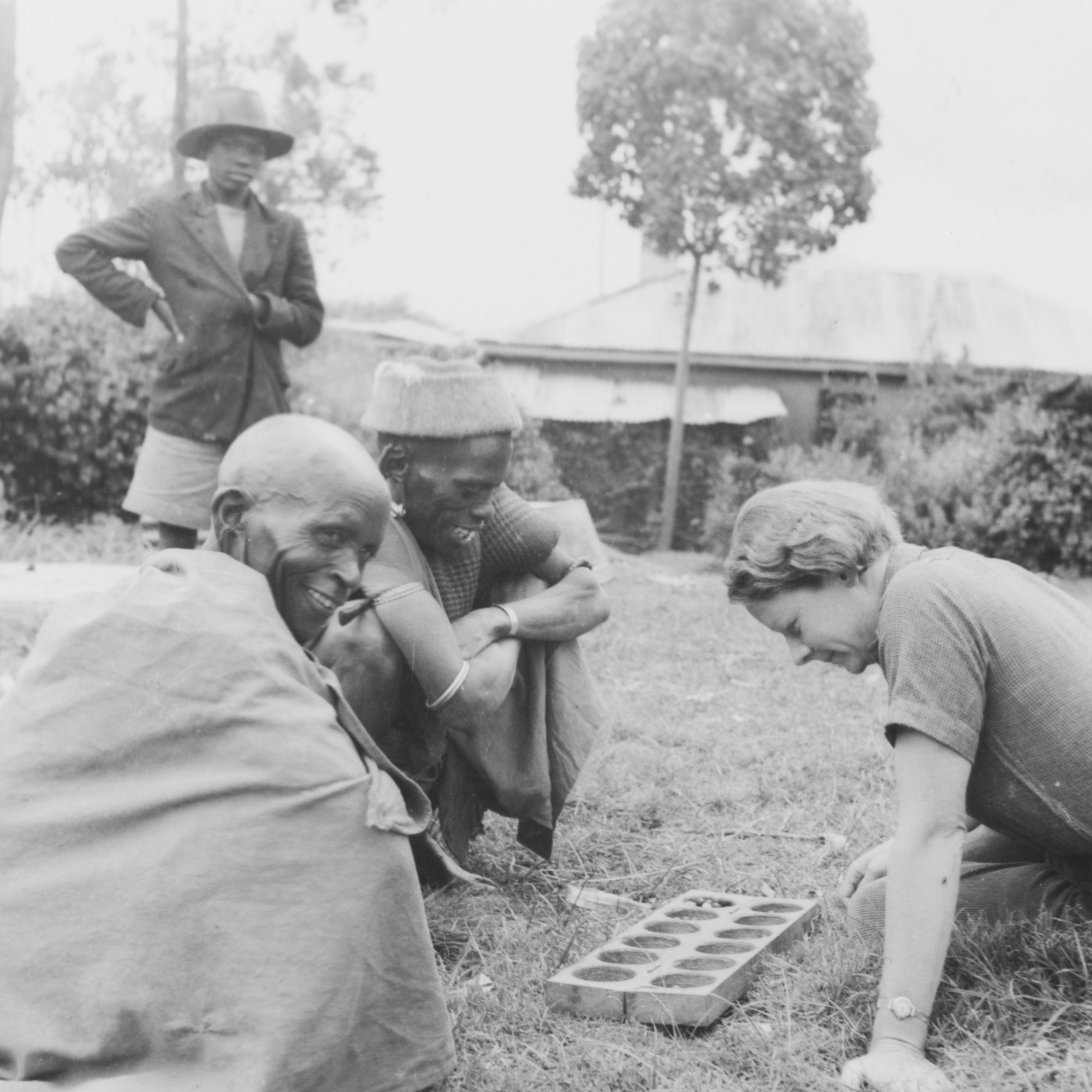 Elspeth Huxley plays a mancala game with two
